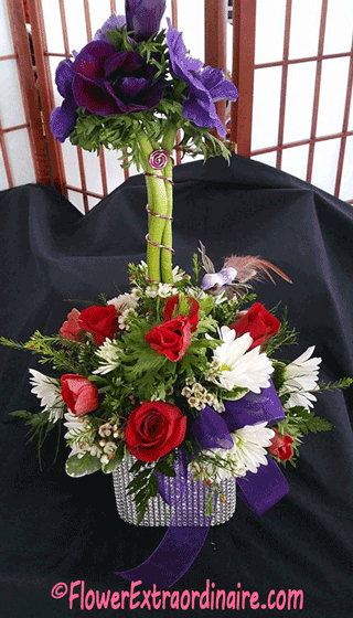 basket of white daisies and red roses + purple flowers and bow